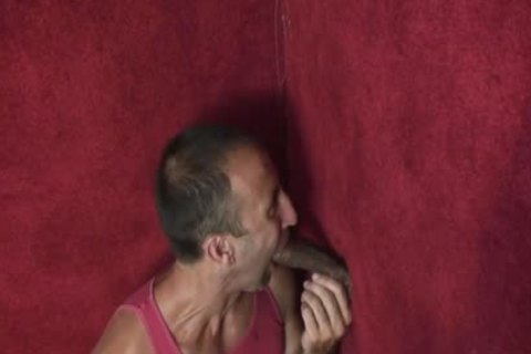 An old boy Enjoys engulfing dong throughout A Gloryhole