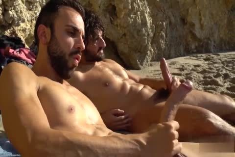 large penises stroking AT THE BEACH