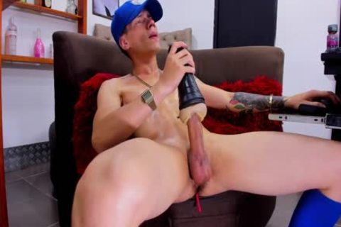 youthful pumped up boy With Tattos Plays With Fleshjack And love juice